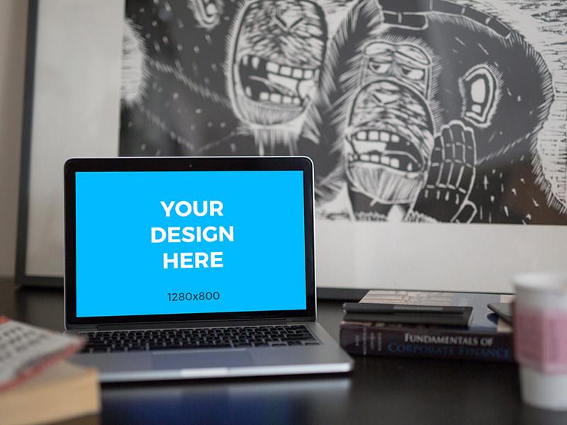 0eb0b44963b1d6fd5d143779dd56024d - MacBook Pro on black table