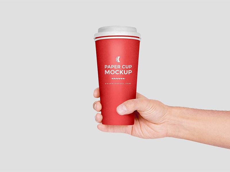 323d3c93fd0114a4bcd0735a83f8b4e7 - Paper Cup In Hand Mockup PSD