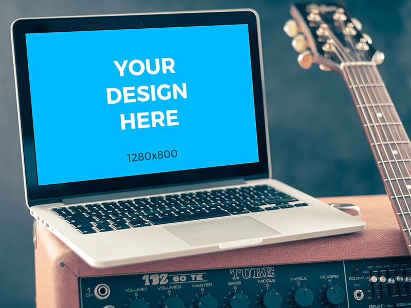 6ef8e3f4342cac1c59df63d4db04e1d2 - MacBook Pro with guitar