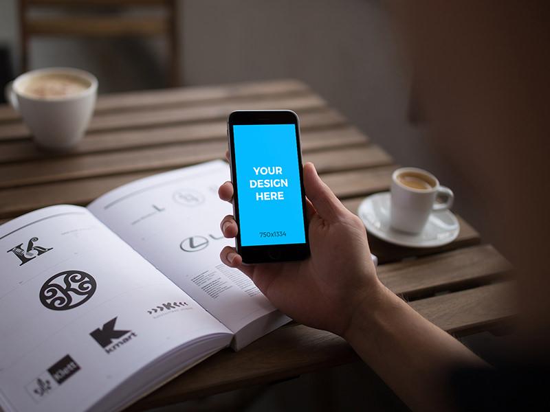 73bc2bc61d66a70eb8f1485b515a7e37 - Woman with iPhone 6S reading a design book - Free Mockup