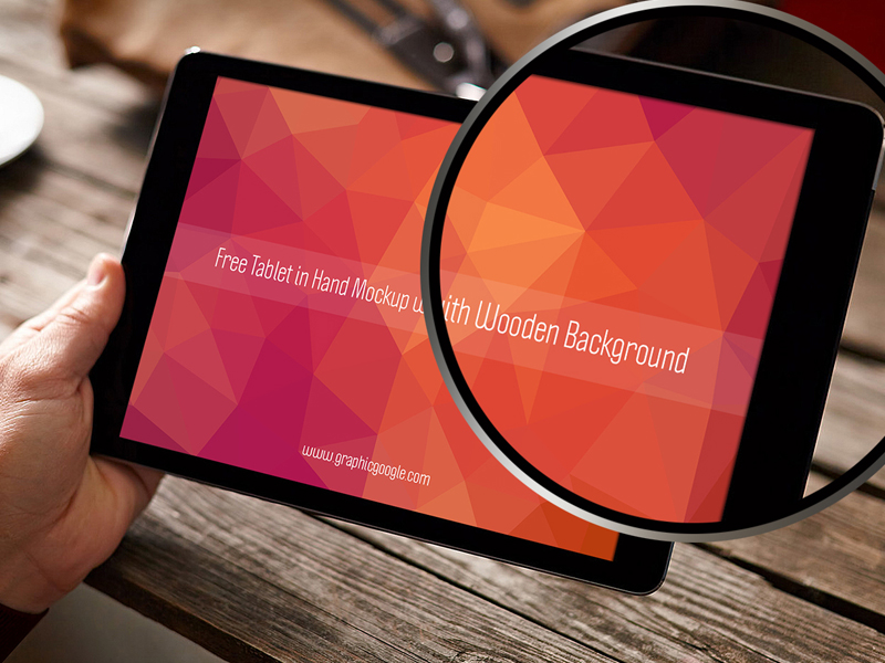 c2dba0bafbd70220ae0f31cff80eacab - Free Tablet In Hand Mockup With Wooden Background