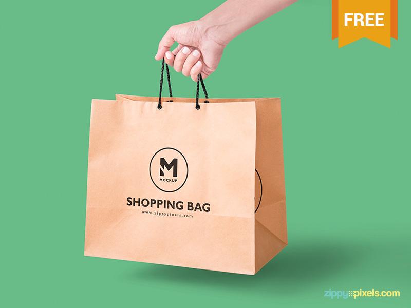 db81740b646527b84c2fc4fbaf47215e - Free Handheld Paper Bag Mockup