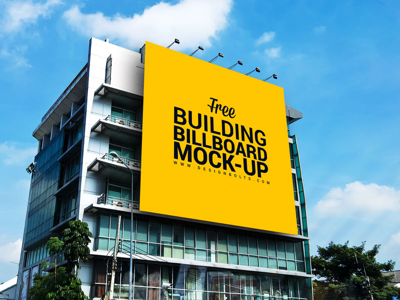 dc4ad0ec1f6775704ee175a4ca1006bf - Free Outdoor Advertisement Building Billboard Mockup PSD