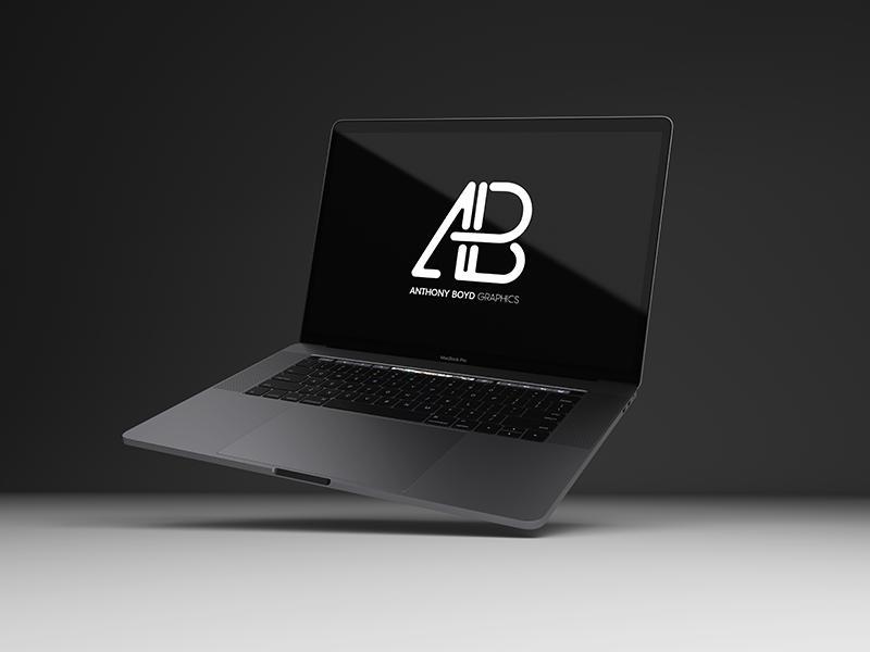 e7c08ee52391d8ba5f6c13320e2bda84 - Realistic 2016 Space Gray MacBook Pro Mockup Vol.8